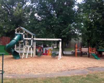Kids and parents love our fenced outdoor Playgrounds!